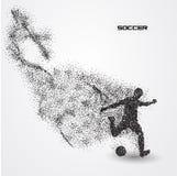 Jogador de futebol do futebol de uma silhueta da partícula Imagem de Stock Royalty Free