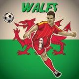 Jogador de futebol de Gales com fundo da bandeira Imagens de Stock Royalty Free