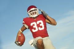 Jogador de futebol na ação do jogo Foto de Stock