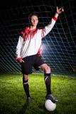 Jogador de futebol na obscuridade Foto de Stock Royalty Free