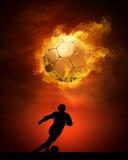 Jogador de futebol nos incêndios Imagem de Stock Royalty Free