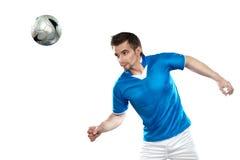 Jogador de futebol novo com a esfera no backgr isolado Imagem de Stock