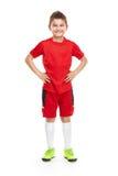 Jogador de futebol novo ereto no sportswear imagem de stock