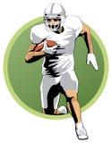 Jogador de futebol que corre com a bola Fotografia de Stock Royalty Free