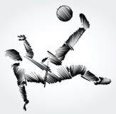 Jogador de futebol que estica para dominar uma bola Imagem de Stock Royalty Free