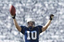 Jogador de futebol que marc um aterragem Fotografia de Stock Royalty Free