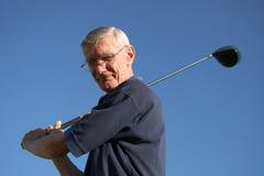 Jogador de golfe idoso Imagens de Stock