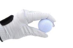 Jogador de golfe que prende uma esfera de golfe Foto de Stock