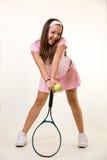 Jogador de ténis feliz na cor-de-rosa imagens de stock royalty free