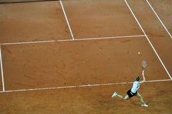 Jogador de ténis na ação Fotografia de Stock Royalty Free