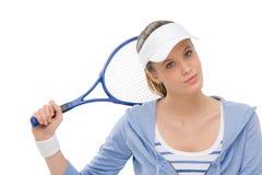 Jogador de ténis - raquete da terra arrendada da mulher nova Foto de Stock