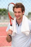 Jogador de tênis com raquete Fotografia de Stock