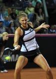 Jogador de tênis da mulher na ação Fotografia de Stock Royalty Free