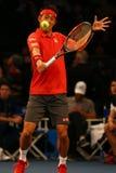 Jogador de tênis profissional Kei Nishikori de Japão na ação durante evento do tênis do aniversário da prova final de BNP Paribas Fotos de Stock