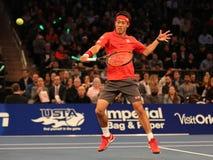 Jogador de tênis profissional Kei Nishikori de Japão na ação durante evento do tênis do aniversário da prova final de BNP Paribas Fotos de Stock Royalty Free