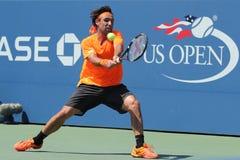 Jogador de tênis profissional Marcos Baghdatis de Chipre na ação durante o fósforo quatro redondo do US Open 2016 foto de stock