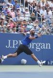 Jogador de tênis profissional Marcos Baghdatis durante o terceiro fósforo do círculo no US Open 2013 contra Stanislas Wawrinka Imagens de Stock