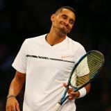 Jogador de tênis profissional Nick Kyrgios de Austrália na ação durante evento do tênis do aniversário da prova final de BNP Pari Imagens de Stock