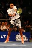Jogador de tênis profissional Nick Kyrgios de Austrália na ação durante evento do tênis do aniversário da prova final de BNP Pari Imagens de Stock Royalty Free