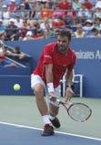 Jogador de tênis profissional Stanislas Wawrinka durante o terceiro fósforo do círculo no US Open 2013 Imagens de Stock Royalty Free