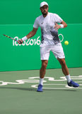 Jogador de tênis profissional Steve Johnson do Estados Unidos na ação durante seu fósforo do círculo 3 do Rio 2016 Jogos Olímpico Imagens de Stock Royalty Free