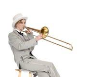 Jogador de trombone assentado Imagens de Stock Royalty Free