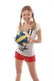 Jogador de voleibol fêmea feliz que guarda a bola Imagem de Stock Royalty Free