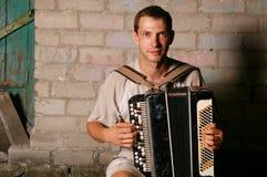 Jogador do acordeão da tecla Fotografia de Stock