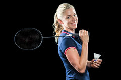 Jogador do badminton que guarda a raquete e a peteca imagem de stock