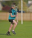 Jogador do Lacrosse das mulheres Fotos de Stock Royalty Free