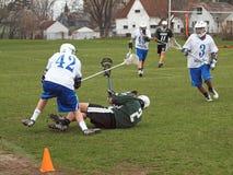 Jogador do Lacrosse para baixo Fotos de Stock Royalty Free