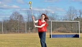 Jogador fêmea novo bonito da lacrosse Foto de Stock Royalty Free