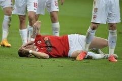 Jogador ferido do futebol ou de futebol Imagem de Stock Royalty Free