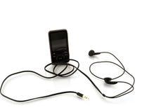 Jogador MP3 com auscultadores Fotografia de Stock