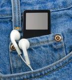 Jogador MP3 no bolso com fones de ouvido imagens de stock