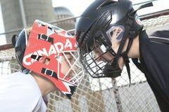 Jogadores da bola do hóquei com vara de hóquei Fotos de Stock Royalty Free