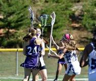 Jogadores da lacrosse das raparigas Fotos de Stock Royalty Free