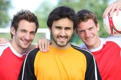 Jogadores de futebol Imagens de Stock