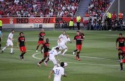 Jogadores de futebol Action_Sports Fans_Photojournalists Foto de Stock