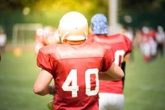 Jogadores de futebol americano na ação Imagem de Stock