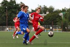 Jogadores de futebol com esfera Foto de Stock Royalty Free