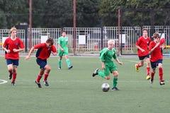 Jogadores de futebol com esfera Foto de Stock