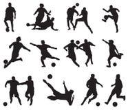 Jogadores de futebol da silhueta Imagem de Stock Royalty Free