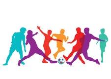 Jogadores de futebol mostrados em silhueta Imagens de Stock