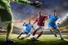 Jogadores de futebol na ação no panorama do fundo do estádio do por do sol Imagens de Stock Royalty Free