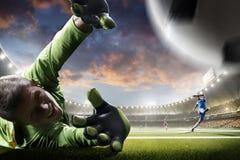 Jogadores de futebol na ação no panorama do fundo do estádio do por do sol Imagem de Stock Royalty Free