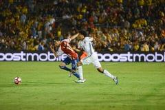Jogadores de futebol que correm durante Copa América Centenario Imagens de Stock