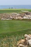 Jogadores de golfe litorais Imagens de Stock