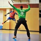 Jogadores do handball na ação Imagens de Stock