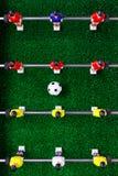 Jogadores do jogo do retrocesso do futebol do futebol da tabela fotografia de stock royalty free